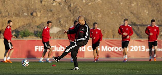 Bayern head coach Pep Guardiola of Spain kicks ball during a last training session at the Club World Cup soccer tournament in Marrakech, Morocco, Friday, Dec. 20, 2013. Bayern Munich will face Raja Ca
