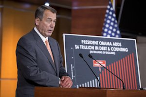 Speaker of the House John Boehner, R-Ohio, speaks with …