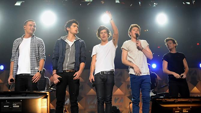 FILE - In this Friday Dec. 7, 2012 file photo, One Direction performs at Z100's Jingle Ball 2012 presented by Aeropostale at Madison Square Garden in New York. Band members, from left, are Liam Payne, Zayn Malik, Harry Styles, Niall Horan, and Louis Tomlinson. MTV on Thursday, Dec. 13, 2012 announced that One Direction is the network's 2012 Artist of the Year. (Photo by Evan Agostini/Invision/AP)