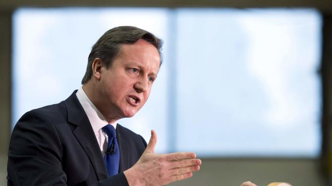 Britain's Prime Minister Cameron delivers a speech at JCB World Headquarters in Rocester, central England