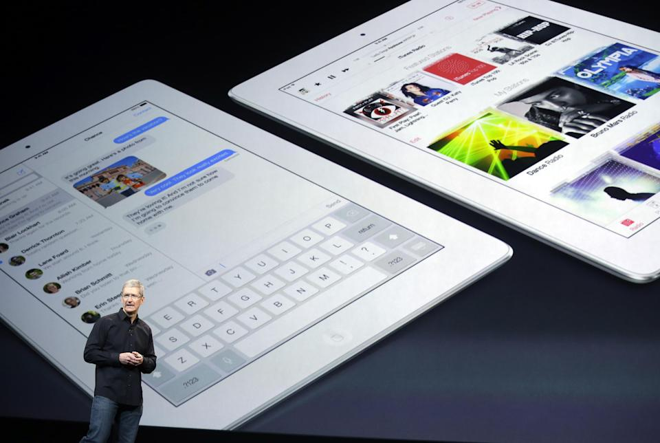 Apple CEO Tim Cook speaks on stage before a new product introduction on Tuesday, Oct. 22, 2013, in San Francisco. (AP Photo/Marcio Jose Sanchez)