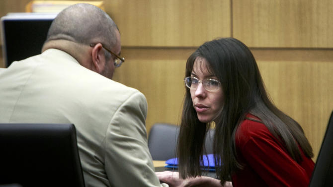 Defendant Jodi Arias confers with her attorney, Kirk Nurmi, during her trial at the Maricopa County Superior Court on Tuesday, Jan. 15, 2013, in Phoenix. Arias is charged with murder in the death of her boyfriend, Travis Alexander, and prosecution is seeking the death penalty.(AP Photo/The Arizona Republic, Charlie Leight)