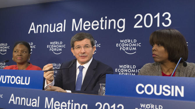 Turkish Foreign Minister Ahmet Davutoglu, center, gestures as he speaks to the media as United Nation Under-Secretary-General for Humanitarian Affairs and Emergency Relief Coordinator, British Valerie Amos, left, and Executive Director of the United Nation World Food Programm, American Ertharin Cousin, right, sit next to him during a press conference on Syria at the 43rd Annual Meeting of the World Economic Forum, WEF, in Davos, Switzerland, Wednesday, Jan. 23, 2013. (AP Photo/Michel Euler)