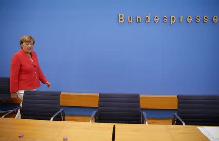 German Chancellor Merkel arrives to address an annual news conference in Berlin