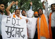 Right-wing Hindu organisation Shiv Sena activists and shopkeepers shout slogans with an effigy of Indian Prime Minister Manmohan Singh during a demonstration against the foreign direct investment (FDI) in multi-brand retail, in Amritsar, on September 15