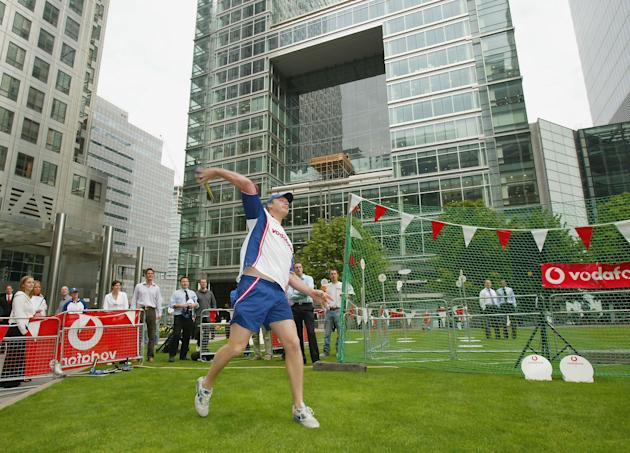LONDON - SEPTEMBER 2:  Andrew Flintoff of England throws a Vortex ball before the public challenge his throw during the Vodafone Challenge Andrew Flintoff Competition in Canada Square Gardens on Septe
