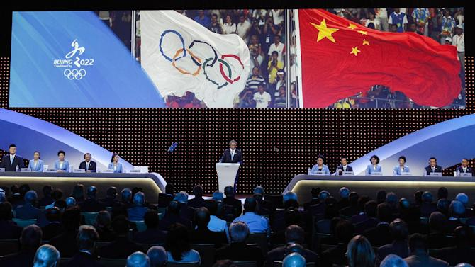 Chinese delegation, from left, Yao Ming, Li Nina, Yang Lan, Liu Peng, Yang Yang, Vice President of the China Olympics Council Yu Zaiqing, China Vice Premier Liu Yandong, Wang Anshun, Zhang Haidi, Li Lingwei, Hou Liang and Zhang Li attend the Beijing's bid presentation for the host city for the 2022 Winter Games, at the 128th International Olympic Committee session in Kuala Lumpur, Malaysia, Friday, July, 31, 2015. (AP Photo/Joshua Paul)