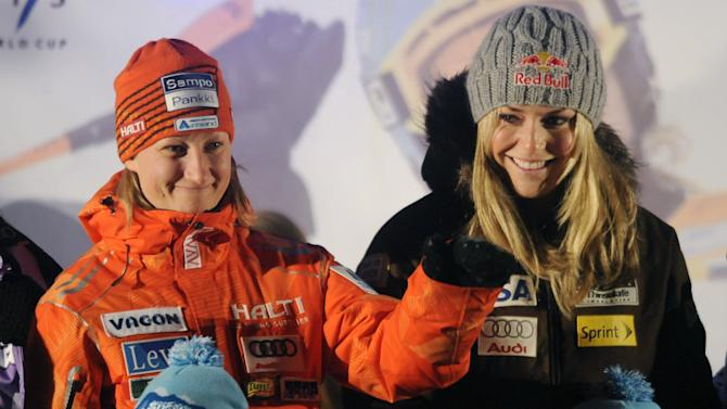 Tanja Poutiainen, left of Finland and Lindsey Vonn of the US, pose during the public draw of the ladies FIS Alpine Ski slalom World Cup, Friday, Nov. 12, 2010 in Levi, Finland. (AP Photo, Lehtikuva,Mikko Stig ** FINLAND OUT. NO THIRD PARTY SALES. **
