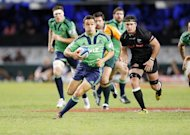 New Zealand's Otago Highlanders player Tamati Ellison (C) makes a run during a Super 15 rugby match against South Africa's Coastal Sharks, at the Kings Park Rugby Stadium in Durban, on May 5, 2012. The Highlanders host the Waikato Chiefs on Friday, in Dunedin, as the Chiefs prepare to open their Super 15 title defence