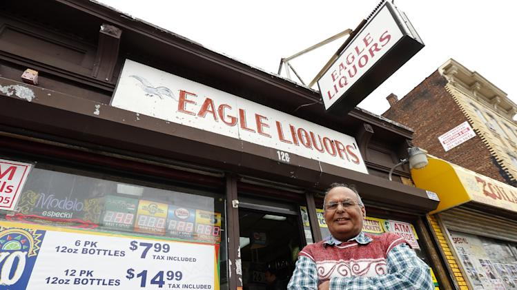 Store employee Pravin Mankodia stands outside Eagles Liquors in Passaic, N.J. Monday, March 25, 2013. Mankodia sold the winning $338 million Powerball ticket that was claimed by an unidentified New Jersey Resident. (AP Photo/Rich Schultz)