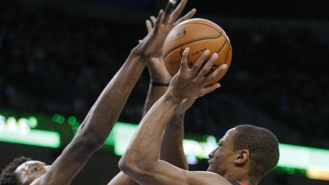 Toronto Raptors guard DeMar DeRozan (10) looks for a shot against Oklahoma City Thunder center Hasheem Thabeet, left, as Thunder forward Nick Collison falls to the floor in the first quarter of an NBA basketball game in Oklahoma City, Tuesday, Nov. 6, 2012. (AP Photo/Alonzo Adams)