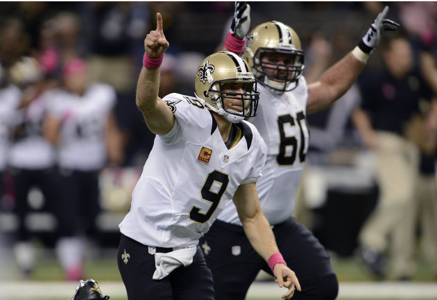 New Orleans Saints quarterback Drew Brees (9) reacts after completing a touchdown pass for his 48th consecutive game, breaking Johnny Unitas' NFL record which stood for over 50 years, during an NFL fo