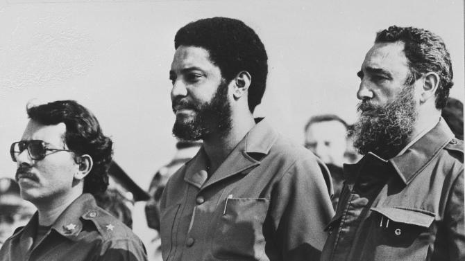 In this May 1, 1980 file photo, then Grenada's Prime Minister Maurice Bishop, center, is flanked by Cuba's leader Fidel Castro, right, and Nicaragua's President Daniel Ortega in Havana, Cuba. A haunting Cold War mystery is getting a fresh look on the Caribbean island of Grenada, where the body of the Marxist prime minister is still missing nearly 30 years after he was executed during a bloody coup that sparked a U.S. invasion. (AP Photo/File)
