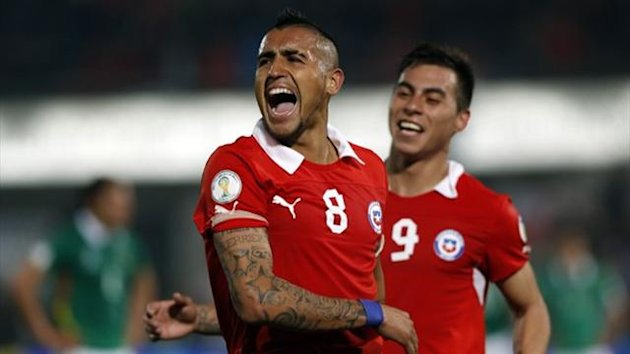 Chile's Arturo Vidal (L) celebrates after scoring against Bolivia in a 2014 World Cup qualifying match in Santiago (Reuters)