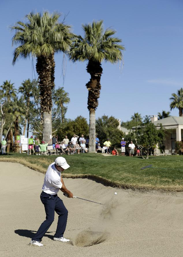 Charles Howell III hits from a greenside bunker on the third hole during the final round of the Humana Challenge golf tournament on the Palmer Private Course at PGA West in La Quinta, Calif., Sunday, Jan. 20, 2013. (AP Photo/Ben Margot)