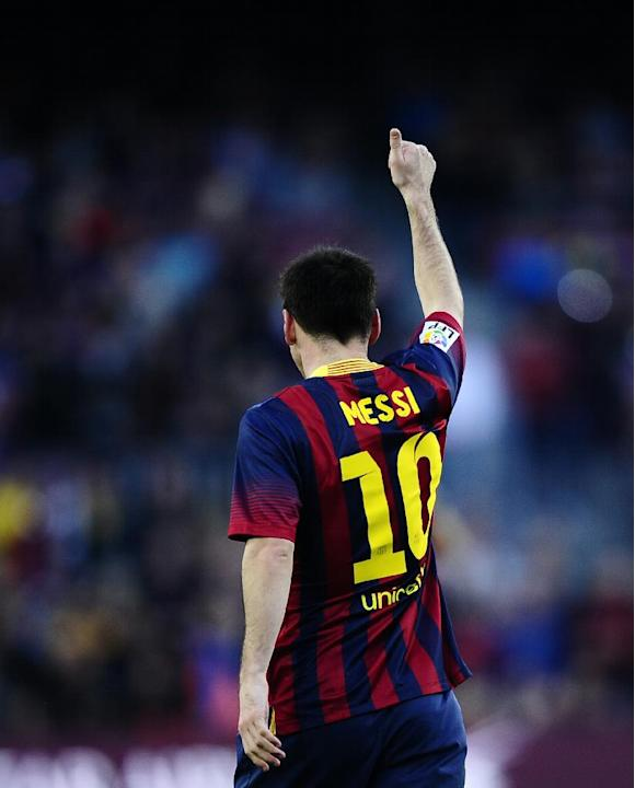 FC Barcelona's Lionel Messi, celebrates after scoring during the Spanish La Liga soccer match between FC Barcelona and Osasuna at the Camp Nou stadium in Barcelona, Spain, Sunday, March 16, 2014