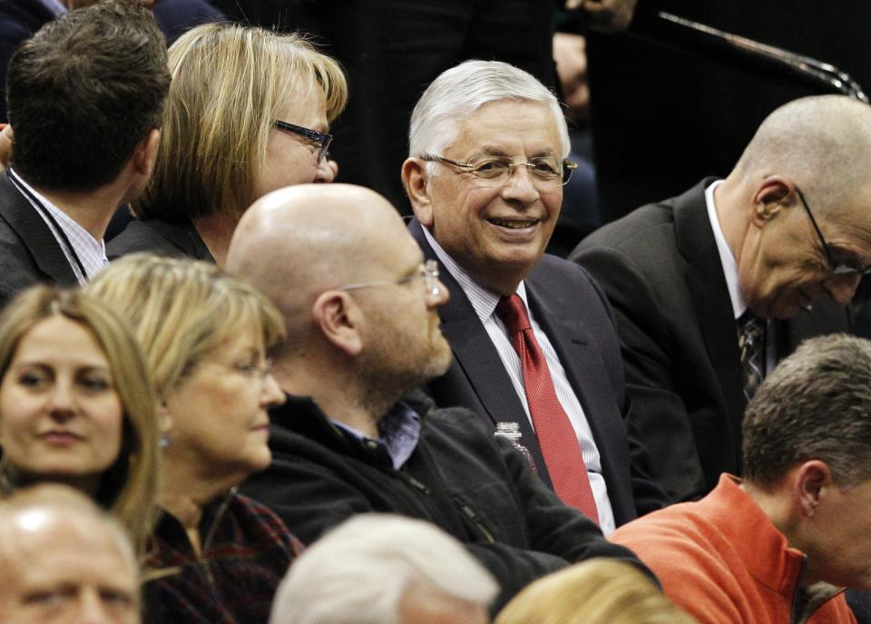 NBA Commissioner David Stern sits in the stands during the first half of an NBA basketball game between the Minnesota Timberwolves and the San Antonio Spurs on Wednesday, Feb. 6, 2013, in Minneapolis. (AP Photo/Genevieve Ross)