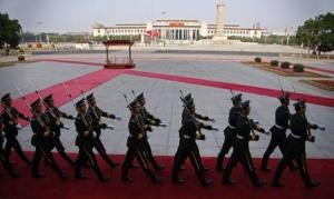 Soldiers from the honour guards of the Chinese People's Liberation Army march in front of the Monument to the People's Heroes at Tiananmen Square in Beijing