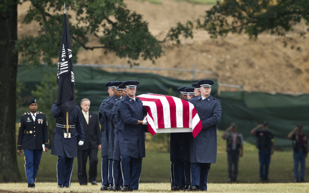 "An Air Force carry team carries the casket with the remains of Air Force Col. Joseph Christiano, Col. Derrell B. Jeffords, Lt. Col. Dennis L. Eilers, Chieft Master Sgt. William K. Colwell, Chief Master Sgt. Arden K. Hassenger and Chief Master Sgt. Larry C. Thornton, during a burial service at Arlington National Cemetery Arlington, Va., Monday, July 9, 2012. It was Christmas Eve 1965 when the Air Force plane nicknamed ""Spooky"" took off from Vietnam for a combat mission. The crew sent out a ""mayday"" signal while flying over Laos, and after that, all contact was lost. Two days of searches turned up nothing. (AP Photo/Haraz N. Ghanbari)"
