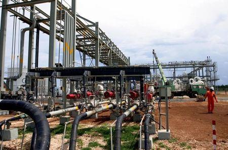 A Tanzanian engineer walks at the Songas gas processing plant on Songo Songo Island Tanzania.