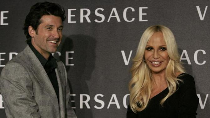 U.S. actor Dempsey and designer Versace pose for photographers before the Versace Fall/Winter 2008/09 women's show during Milan Fashion Week.