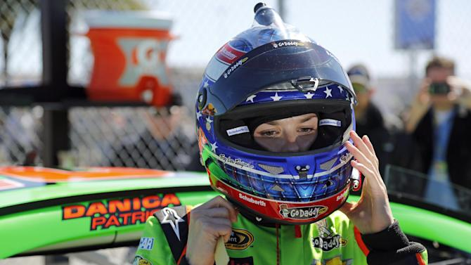 Danica Patrick removes her helmet after her qualifying run for the NASCAR Daytona 500 Sprint Cup Series auto race at Daytona International Speedway, Sunday, Feb. 17, 2013, in Daytona Beach, Fla. Patrick won the pole, becoming the first woman to secure the top spot for any Sprint Cup race. (AP Photo/Terry Renna)