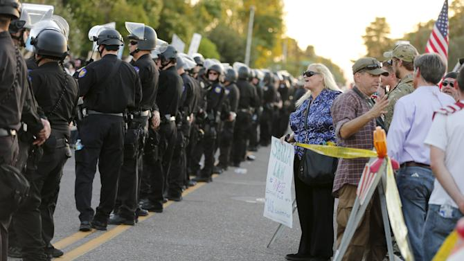 "Police line separates people attending ""Freedom of Speech Rally Round II"" from counter demonstrators outside Islamic Community Center in Phoenix"