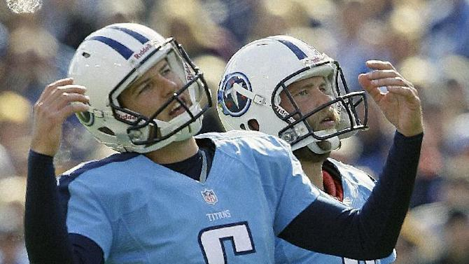 Tennessee Titans punter Brett Kern (6) reacts to a missed field goal as Titans kicker Rob Bironas (2) looks on  during the second half of an NFL football game against the Indianapolis Colts, Sunday, Oct. 28, 2012, in Nashville, Tenn. (AP Photo/Wade Payne)