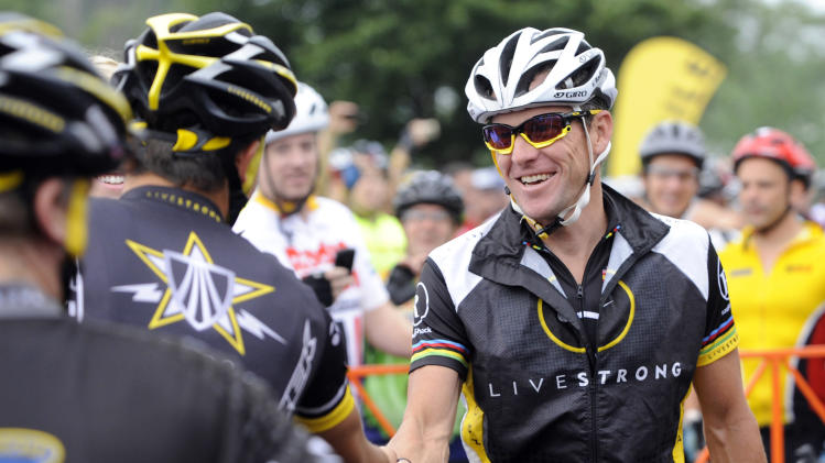 In this Aug. 22, 2010, file photo, cyclist Lance Armstrong greets fellow riders prior to the start of his Livestrong Challenge 10K ride for cancer in Blue Bell, Pa. Armstrong said Wednesday, Oct. 17, 2012, he is stepping down as chairman of his Livestrong cancer-fighting charity so the group can focus on its mission instead of its founder's problems. The move came a week after the U.S. Anti-Doping Agency released a massive report detailing allegations of widespread doping by Armstrong and his teams when he won the Tour de France seven consecutive times from 1999 to 2005. (AP Photo/Bradley C Bower, File)