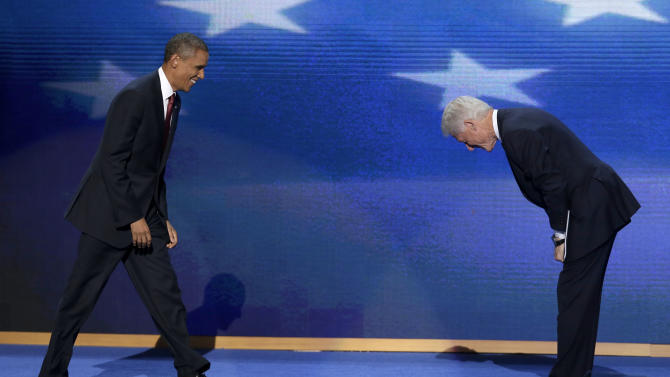 Former President Bill Clinton bows as President Barack Obama walks on stage after Clinton's address to the Democratic National Convention in Charlotte, N.C., on Wednesday, Sept. 5, 2012. (AP Photo/J. Scott Applewhite)