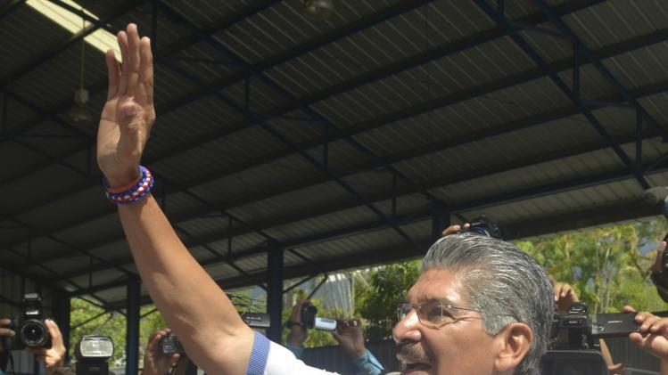 Quijano greets members of the media after casting his vote in a presidential election runoff in San Salvador