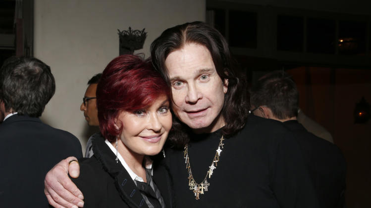 Sharon Osbourne and Ozzy Osbourne attend a Grammy Party hosted by Lucian Grainge on Sunday, Feb. 10, 2013 in Los Angeles. (Photo by Todd Williamson/Invision/AP)