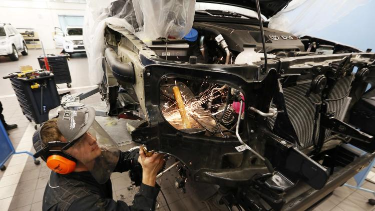 A Russian mechanic works on an Arctic Trucks all-terrain vehicle, based on the Toyota Hilux pickup, at an assembly shop of the Arctic Trucks Russia plant in Krasnoyarsk