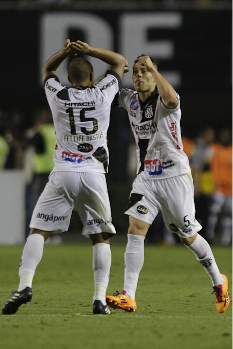 Felipe Bastos of Brazil's Ponte Preta, left, celebrates with teammate Baraka after scoring against Argentina's Lanus during the first leg match of Copa Sudamericana final in Sao Paulo, Brazil,