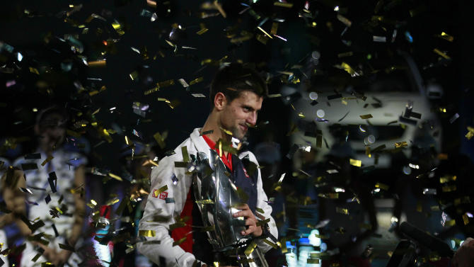 Novak Djokovic of Serbia holds the champion trophy during the award ceremony of the men's singles of at the Shanghai Masters tennis tournament at Qizhong Forest Sports City Tennis Center in Shanghai, China, Sunday Oct. 14, 2012.  Djokovic won Andy Murray of Britain 5-7, 7-6 (11), 6-3 in their final. (AP Photo/Eugene Hoshiko)