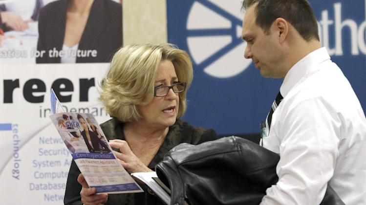 In this Wednesday, Jan. 22, 2014, photo, a recruiter Valera Kulow, left, speaks with job seeker Leonardo Vitiello during a career fair in Dallas. The Labor Department releases job openings and labor turnover survey for January on Tuesday, March, 11, 2014. (AP Photo/LM Otero)