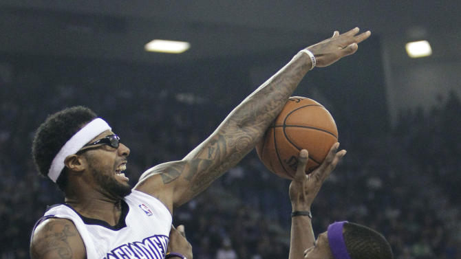 Sacramento Kings forward James Johnson, left, blocks the shot of Los Angeles Lakers center Dwight Howard during the first quarter of an NBA basketball game in Sacramento, Calif., Wednesday, Nov. 21, 2012. (AP Photo/Rich Pedroncelli)