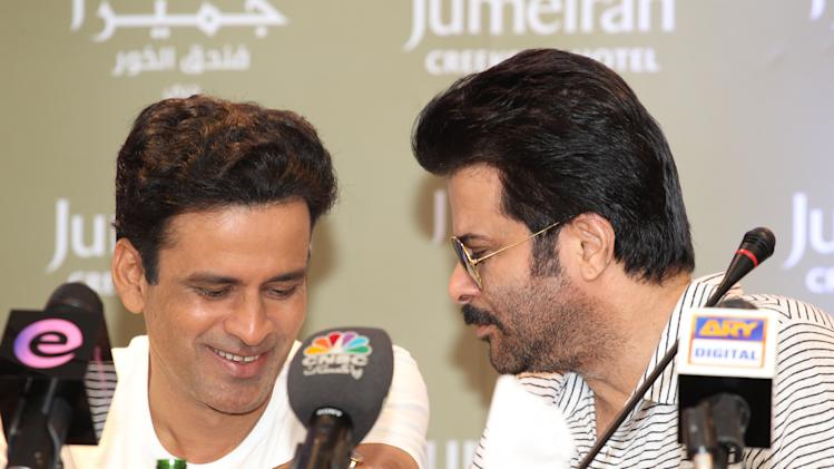 Anil Kapoor has a quiet word with Manoj Bajpai during the conference. Sanish Cherian/Yahoo! Maktoob