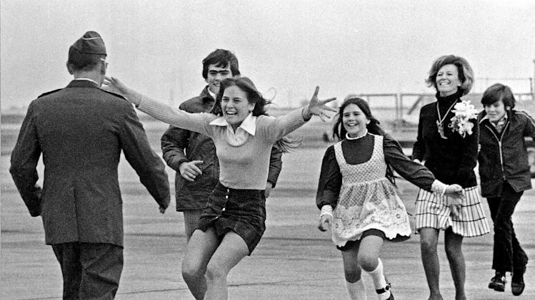 FILE - This March 17, 1973 file photo shows released prisoner of war Lt. Col. Robert L. Stirm being greeted by his family at Travis Air Force Base in Fairfield, Calif., as he returns home from the Vietnam War.  In the lead is Stirm's daughter Lori, 15; followed by son Robert, 14; daughter Cynthia, 11; wife Loretta and son Roger, 12. On Thursday, May 24, 2013, some 200 former POWs, almost all of them former pilots, will reunite for a three-day celebration at the Richard Nixon Presidential Library & Museum in Yorba LInda, Calif., that coincides with the 40th anniversary of a star-studded White House dinner hosted by President Nixon to honor their sacrifice.  At the time, Nixon was embroiled in Watergate, but the former prisoners, now in their 60s and 70s, credit him with their freedom and have no qualms about expressing their loyalty for the 37th president.  This photo won the Pulitzer Prize for News Photography in 1973. (AP Photo/Sal Veder, File)