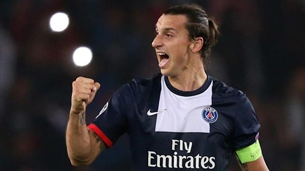Paris Saint-Germain forward Zlatan Ibrahimovic celebrates after scoring against Benfica (AFP)