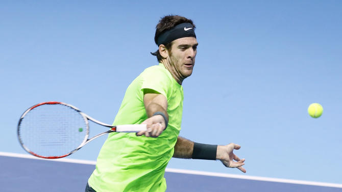 Juan Martin Del Potro of Argentina plays a return to Roger Federer of Switzerland, during their singles tennis match at the ATP World Tour Finals, in London Saturday, Nov. 10, 2012. (AP Photo/Kirsty Wigglesworth)