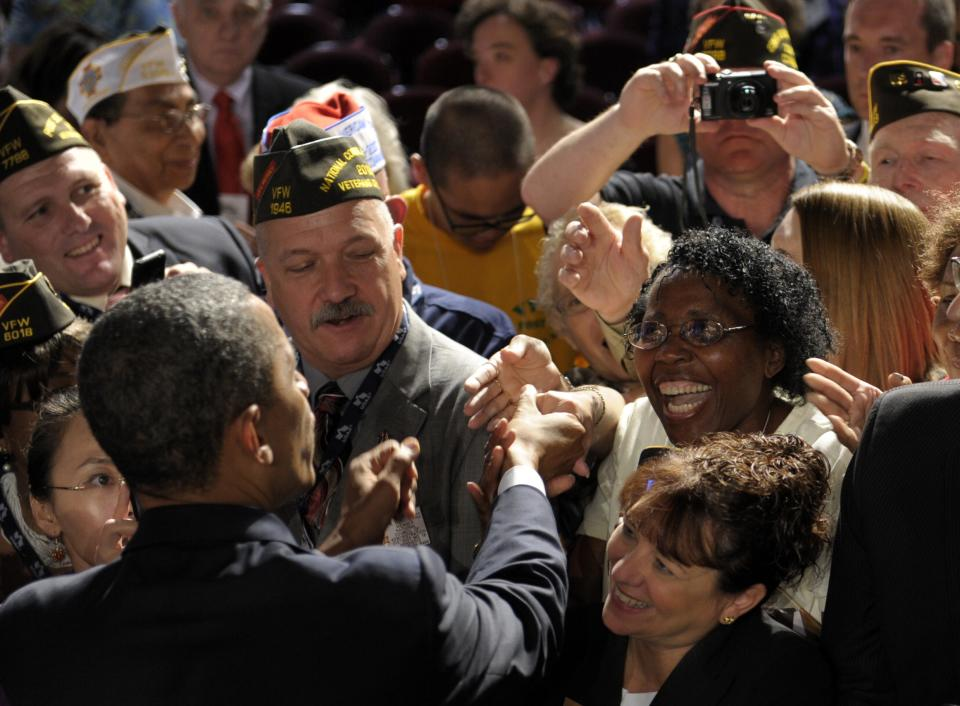 President Barack Obama greets the crowd after speaking at the 113th National Convention of the VFW in Reno, Nev., Monday, July 23, 2012. (AP Photo/Susan Walsh)