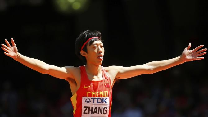 Zhang of China gestures as he competes in the men's high jump qualifying round during the 15th IAAF World Championships at the National Stadium in Beijing