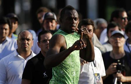 Jamaican sprinter Usain Bolt gestures before competing in a race against a public bus during a demonstration event in Buenos Aires