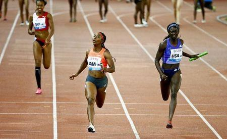 Fraser-Pryce of Jamaica crosses the finish line to win the 4x100m event at the IAAF Athletics Diamond League meeting in Zurich