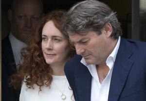 Former News International chief executive Rebekah Brooks and her husband Charlie leave the Old Bailey courthouse in London