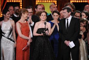 Kristin Caskey, center, along with cast and crew accepts …
