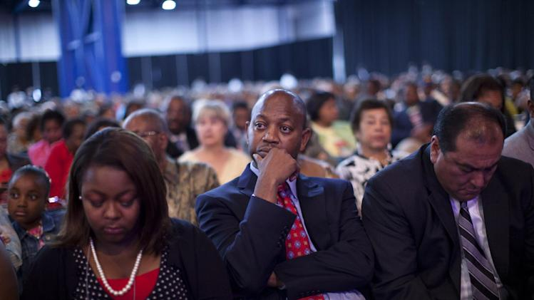 N. Scott Phillips of Baltimore, center, and others, listen as Republican presidential candidate, former Massachusetts Gov. Mitt Romney speaks at the NAACP annual convention, Wednesday, July 11, 2012,  in Houston, Texas.  (AP Photo/Evan Vucci)