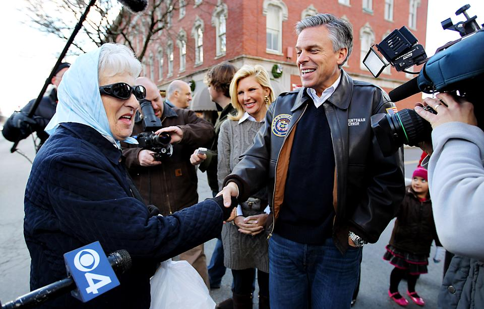 Republican presidential candidate, former Utah Gov. Jon Huntsman, accompanied by his wife Mary Kaye, stops to shake hands while touring businesses in downtown Nashua, N.H., Monday, Jan. 2, 2012.  (AP Photo/Cheryl Senter)