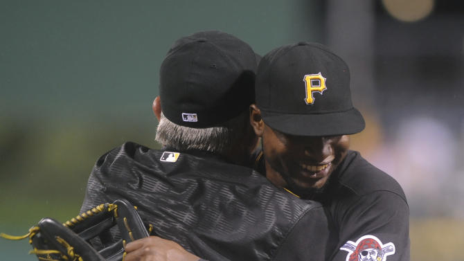 Pittsburgh Pirates manager Clint Hurdle gives a hug to Gregory Polanco after the Pirates defeated the San Diego Padres 3-2 in a baseball game in Pittsburgh, Tuesday, July 7, 2015. (AP Photo/Vincent Pugliese)